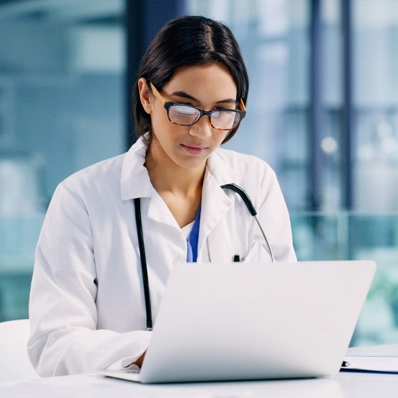 doctor looking at computer