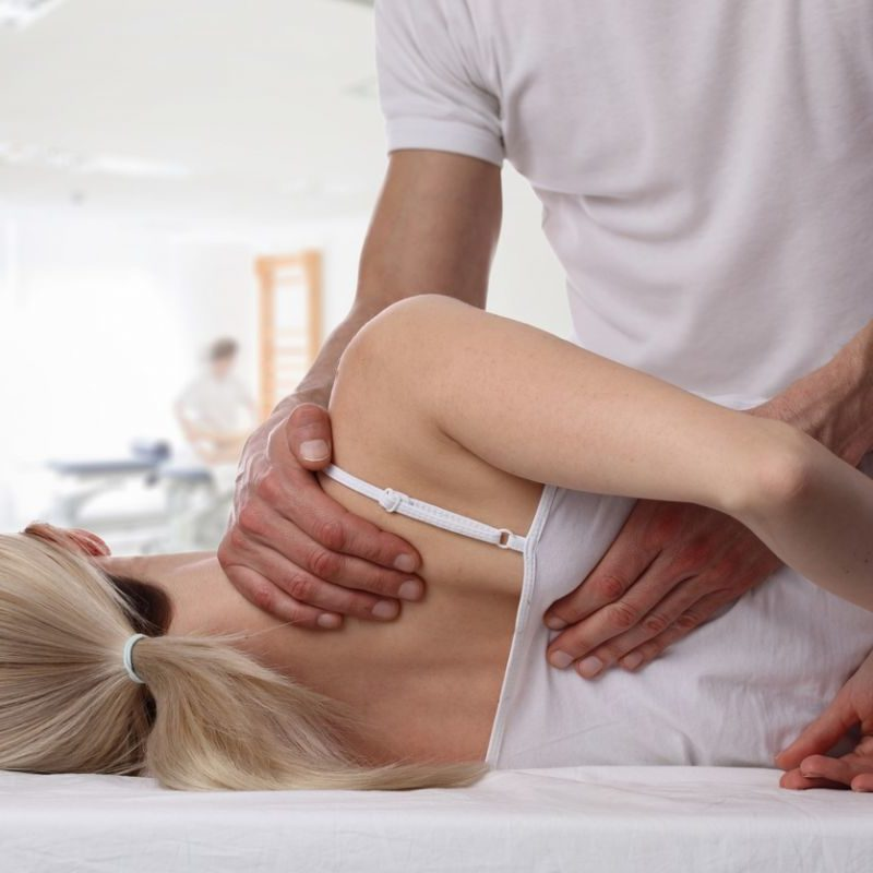 woman being seen by chiropractor