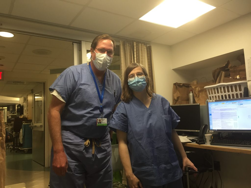 Doctors posing for picture with masks on
