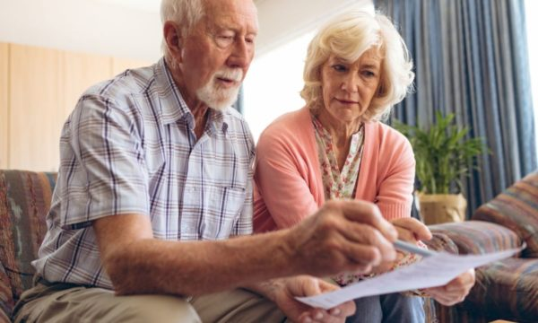 elderly couple reviewing document