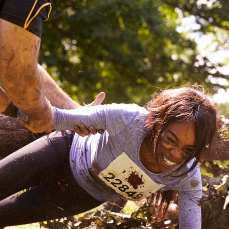 Woman completing obstacle course