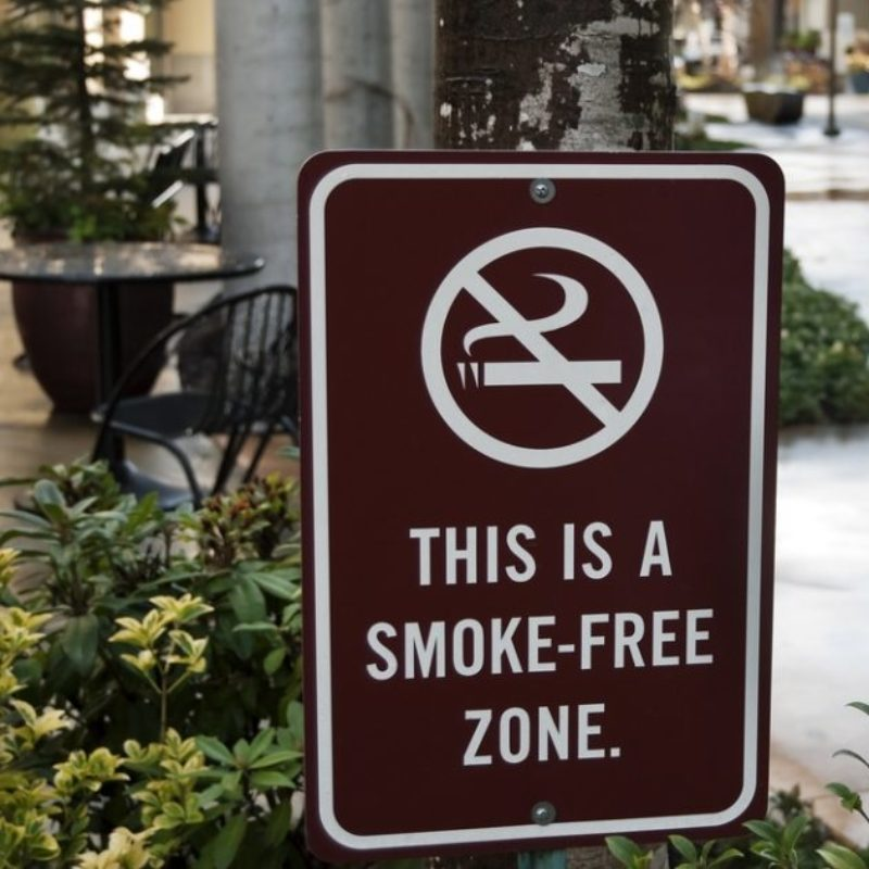 """Sign saying """"This is a smoke-free zone"""""""