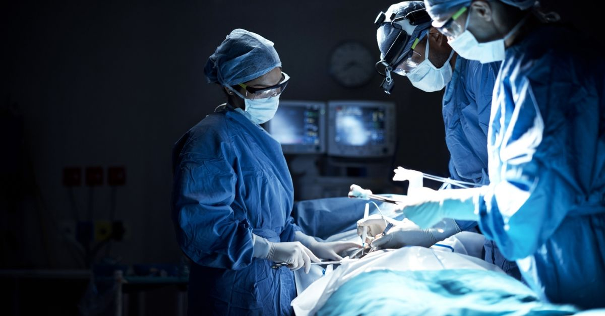 surgeons performing surgery in the OR