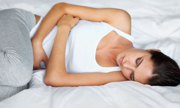 woman lying down with pelvic pain
