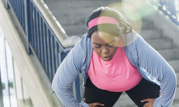 Woman breathing heavily after working out