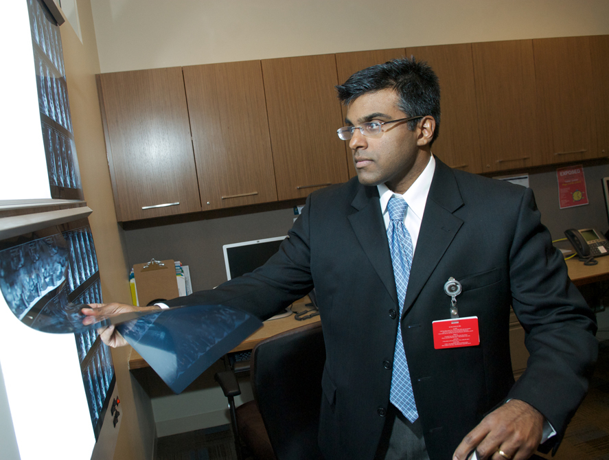 Zacharia Isaac, MD, examines imaging