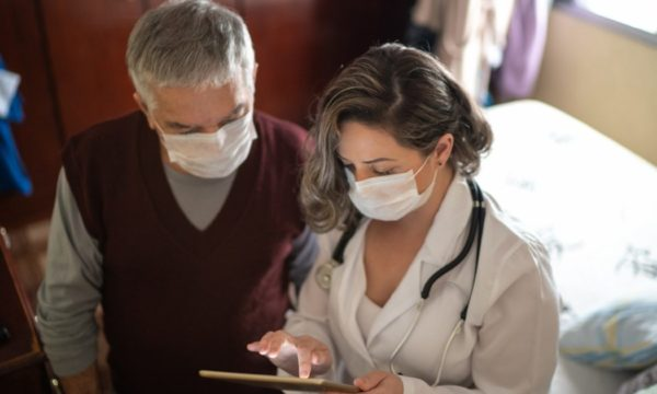 doctor and patient both wearing masks