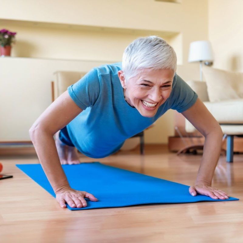 older woman doing plank for strength exercise