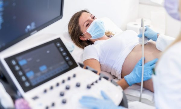 Women having an ultrasound in a mask