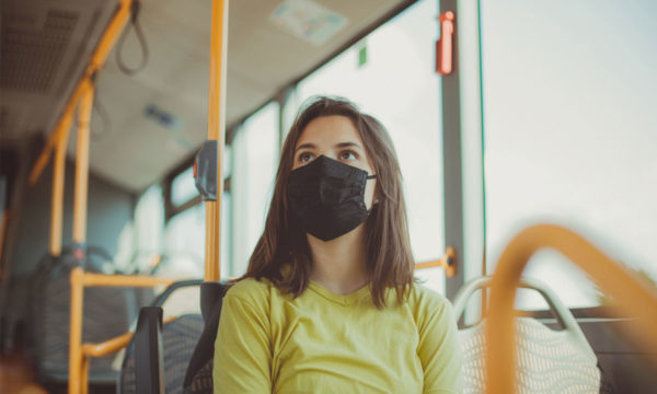 Masked woman on bus